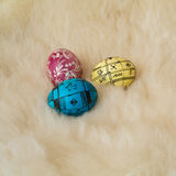 Easter eggs painted in the traditional way. Lying on sheep's fur Royalty Free Stock Photo