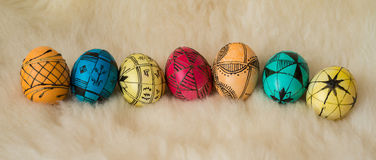 Easter eggs painted in the traditional way. Lying on sheep's fur Royalty Free Stock Photos