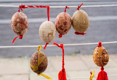 Easter eggs painted in the traditional way. On the string Stock Photography