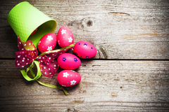Easter eggs painted on the wooden background. Stock Photography