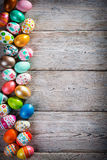 Easter eggs painted on a wooden background. Stock Image