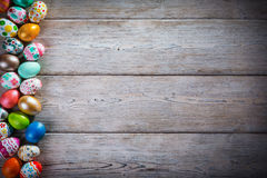Easter eggs painted on a wooden background. Royalty Free Stock Photo