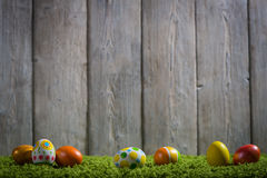 Easter eggs painted on a wooden background. Easter eggs painted on a wooden background of boards Stock Photography
