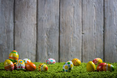 Easter eggs painted on a wooden background. Easter eggs painted on a wooden background of boards Stock Photo
