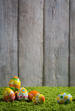 Easter eggs painted on a wooden background. Easter eggs painted on a wooden background of boards Stock Photos