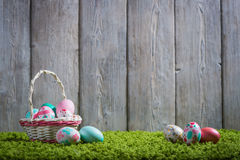 Easter eggs painted on a wooden background. Easter eggs painted on a wooden background of boards and green grass Royalty Free Stock Images