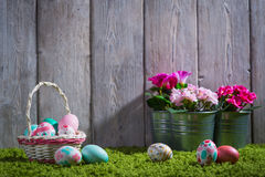 Easter eggs painted on a wooden background. Easter eggs painted on a wooden background of boards and green grass Stock Image