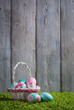 Easter eggs painted on a wooden background. Easter eggs painted on a wooden background of boards and green grass Stock Photos