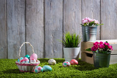 Easter eggs painted on a wooden background. Easter eggs painted on a wooden background of boards and green grass Royalty Free Stock Photography