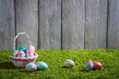Easter eggs painted on a wooden background. Stock Photos