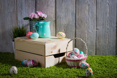 Easter eggs painted on a wooden background. Stock Photo