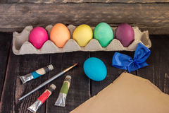 Easter eggs with painting brush and bow on old paper . Ready to paint Stock Photography