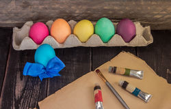 Easter eggs with painting brush on old paper . Ready to paint . Royalty Free Stock Images