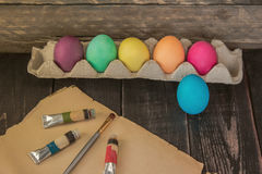 Easter eggs with painting brush on old paper . Ready to paint . Stock Photos