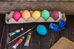 Easter eggs with painting brush and sack . Ready to paint . Happ Stock Photography