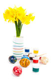 Easter eggs with paints and flowers Royalty Free Stock Photos
