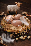 Easter eggs and paper tag with greetings in nest Stock Images