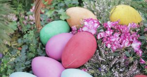 Easter eggs in the park. RUSSIA, MOSCOW - April 25, 2019: Decorative eggs and Easter figures for festive decoration. Charitable festival Easter gift in Moscow in stock footage