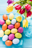 Easter eggs in pastel colors with tulips Stock Images