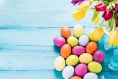 Easter eggs in pastel colors with tulips Royalty Free Stock Photos