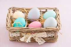 Easter eggs. In pastel colours in a small basket stock photography