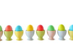 Easter eggs in pastel egg cups Stock Image