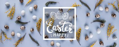 Easter eggs pattern background with spring flowers. Top view. Royalty Free Stock Images