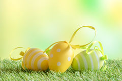 Easter eggs with patterns on green turf Royalty Free Stock Photos