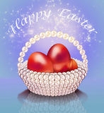 Easter eggs in pearl basket Stock Images