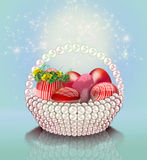 Easter eggs and pearl basket Royalty Free Stock Image
