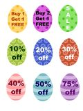 Easter Eggs Percentages Off & BOGO Sale Sign. Colorful Easter Eggs with stripes, dots and flowers have  various percentages off sale signs. Also buy one get one Royalty Free Stock Photography