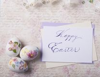 Easter eggs card with caligraphy fonts Stock Images