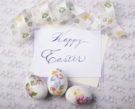 Easter eggs card with caligraphy fonts Royalty Free Stock Photography