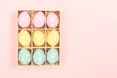 Easter eggs on pink background royalty free stock photo