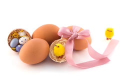 Easter eggs with pink bow and yellow chicken Stock Photo