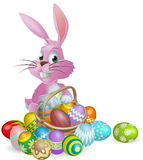 Easter eggs pink bunny. Pink Easter bunny rabbit with Easter eggs basket full of chocolate decorated Easter eggs