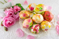Easter eggs and pink roses bouquet Stock Image