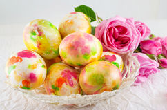 Easter eggs and pink roses bouquet Stock Images
