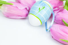Easter eggs with pink tulip flowers Stock Images