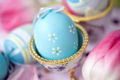 Easter eggs and pink tulips. Close up Royalty Free Stock Images
