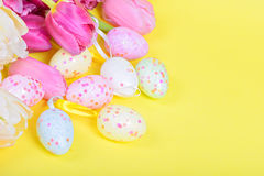 Easter eggs and pink tulips Royalty Free Stock Photos