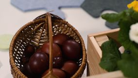Easter egg placed in basket stock footage