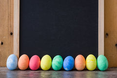 Easter eggs placed in a row with a slate background Stock Images