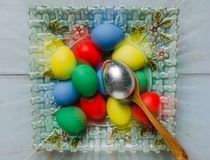 Easter eggs in plate. Easter eggs in a plate on white wooden table Stock Photography