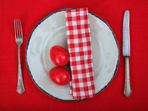 Easter eggs on a plate on red tablecloth Stock Photos