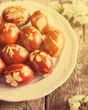 Easter Eggs in Plate on Wooden Table. Toned Stock Image