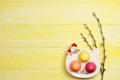 Easter eggs on a plate on a yellow background stock photos