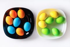 Easter eggs on plates Stock Photos