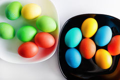 Easter eggs on plates Stock Photography