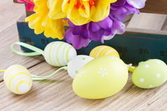 Easter eggs and posy  of spring flowers on wooden Stock Images